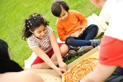 Eating pizza, picnic Royalty Free Stock Photo