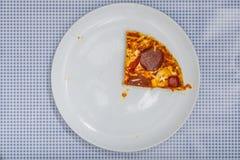 Eating a Pizza Salami, high angle view Stock Image
