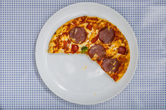 Eating a Pizza Salami, high angle view Stock Photography