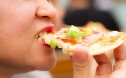 Eating Pizza. With sausage, tomatoes, mushrooms and cheese Royalty Free Stock Image