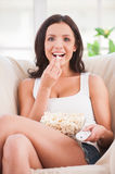 Eating popcorn. Royalty Free Stock Image