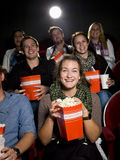 Eating popcorn at the cinema Stock Images