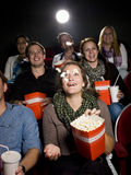 Eating popcorn at the cinema Stock Photos