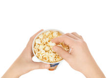 Eating popcorn. On a white background Royalty Free Stock Image