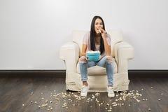 Eating popcorn royalty free stock photos