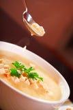 Eating potato cream soup Royalty Free Stock Photos