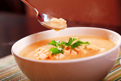 Eating potato cream soup Royalty Free Stock Image