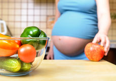 Eating for pregnant woman Stock Image