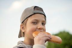 Eating pretzel outdoor Stock Photos