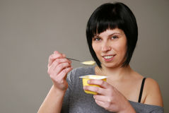 Eating pudding Royalty Free Stock Image