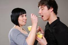 Eating pudding Stock Image
