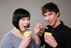 Eating pudding Stock Images