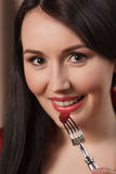 Eating raspberry. Close-up of women eating raspberry using fork Stock Images