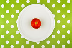 Eating raw red tomato, top view Stock Images