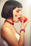 Eating a red apple. Young woman love for fruits. stock images