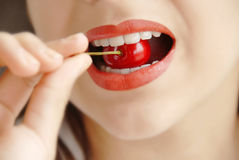 Eating red cherry Royalty Free Stock Photos