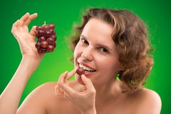 Eating red grape Royalty Free Stock Photos