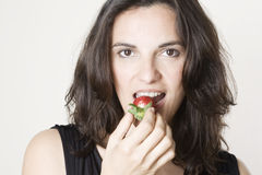 Eating red strawberry Royalty Free Stock Images