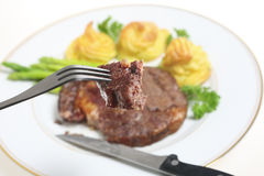 Eating ribeye steak Royalty Free Stock Photos