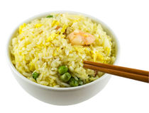 Eating Rice. Eating a bowl of fried rice using chopsticks stock photo