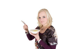 Eating rice with sticks Royalty Free Stock Photos
