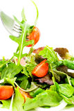 Eating salad. Delicious fresh salad being eaten with fork stock image