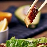 Eating salad with eel Stock Photos