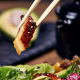 Eating salad with eel Stock Photo