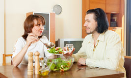 Eating salad vegetables in your home Stock Images