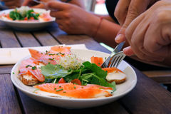 Eating salmon salad Royalty Free Stock Photo