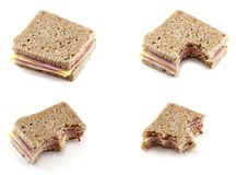 Eating a sandwich of cheese and ham Royalty Free Stock Photos
