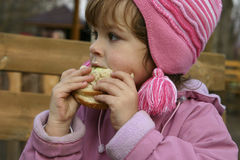 Eating sandwiches. Child eating a sandwich while on a walk Stock Images