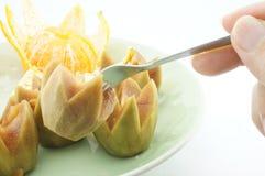 Eating sapodilla and orange. Sweet sapodilla and oranges as snacks healthy Royalty Free Stock Image