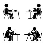 Eating and sitting vector pictogram. Stick figure black and white boy set symbol icon on white. Eating and sitting vector pictogram. Stick figure black and Royalty Free Stock Photos
