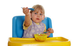 Eating small young girl Stock Image