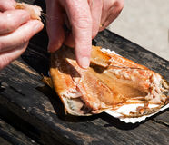 Eating smoked herring Royalty Free Stock Image