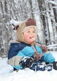 Eating snow. Baby eating snow in nature during winter Royalty Free Stock Photography