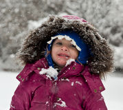 Eating Snowflakes. Little Girl Eating Falling Snow Royalty Free Stock Photo