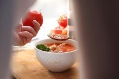 Eating soup. Home-made tasty tomato soup with noodles. stock photo