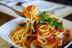 Eating spagetti seafood Stock Photo