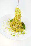 Eating spaghetti mixed with pesto Royalty Free Stock Photo