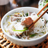 Eating a steamy bowl of pho Stock Images
