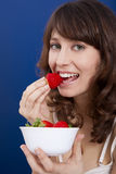 Eating strawberries Stock Photography
