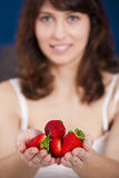 Eating strawberries Stock Images