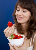 Eating strawberries Royalty Free Stock Photography