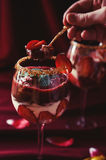 Eating strawberries, chocolate and mascarpone trifle. Strawberries, chocolate and mascarpone trifle in wine glasses- closeup stock photography
