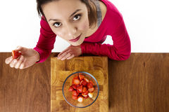 Eating strawberries Royalty Free Stock Photo