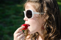 Eating a strawberry 2 Stock Photography