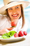 Eating strawberry Royalty Free Stock Photo