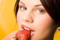 Eating strawberry Royalty Free Stock Photography